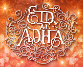 Islamic calligraphy with abstract decor of text Eid-al-Adha on blurred background for Muslim festival celebrations. Template for greeting card