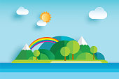 Island and sea in summer origami paper art background. Seascape with mountain and sky.