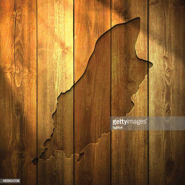 Isle of Man Map on lit Wooden Background