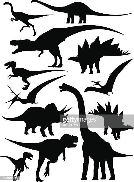 Isolated silhouettes of different types of dinosaurs