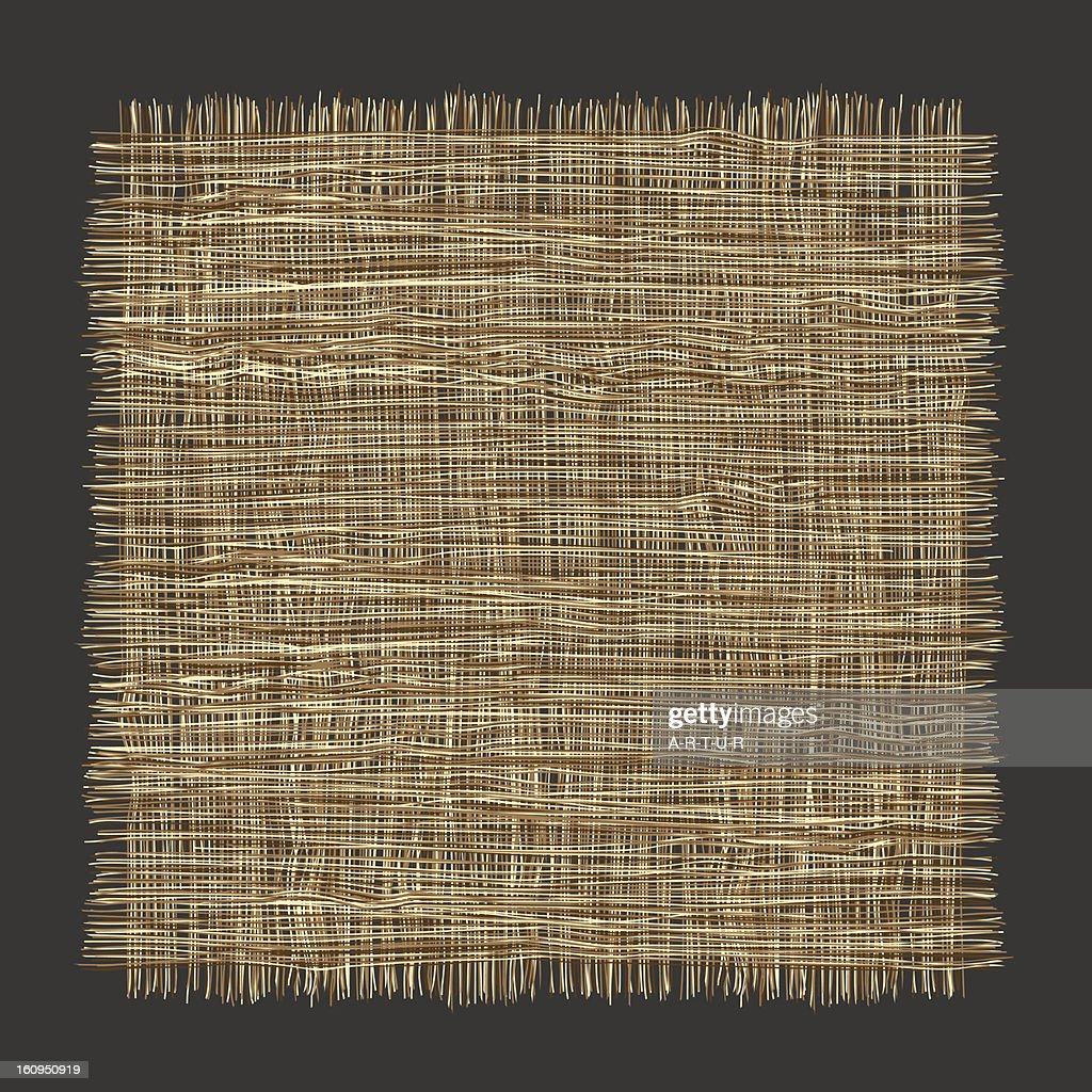 Isolated swatch of rough woven fabric on a dark background