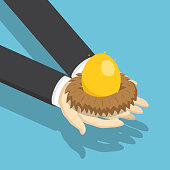Isometric businessman holding nest with golden egg.