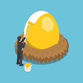 Isometric businessman painting golden color on the egg.