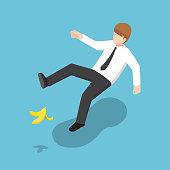 Isometric businessman slipped on a banana peel.