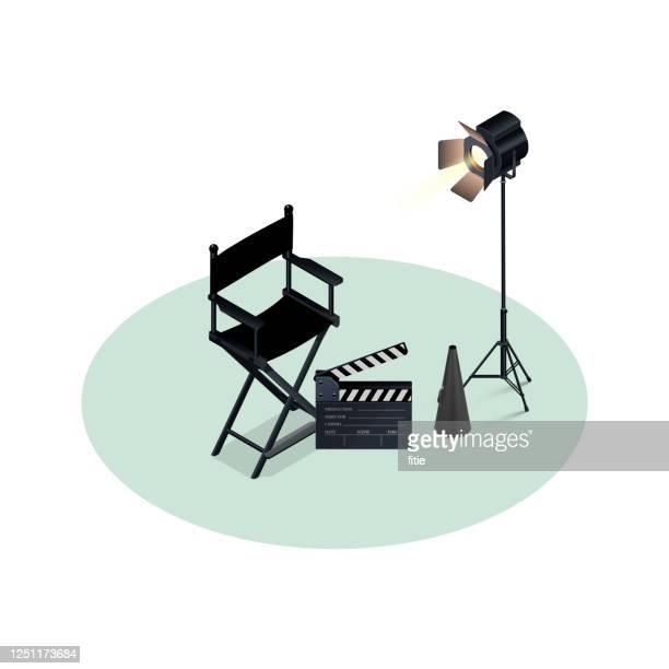 bildbanksillustrationer, clip art samt tecknat material och ikoner med isometrisk vektor illustration av filmregissör samling med hög detaljerad fotostudio ljus. - film and television screening