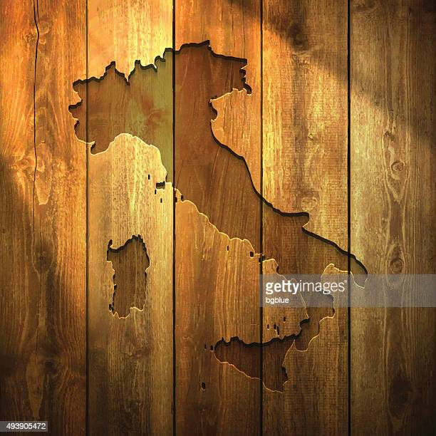 italy map on lit wooden background - sicily stock illustrations, clip art, cartoons, & icons