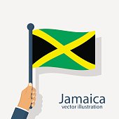 Jamaica flag holding in hand man.