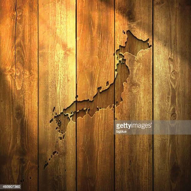 Japan-Karte auf beleuchtete hölzerne Hintergrund