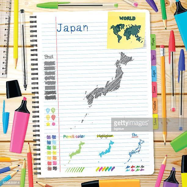 日本の上に手描きされた地図ノートます。木の背景