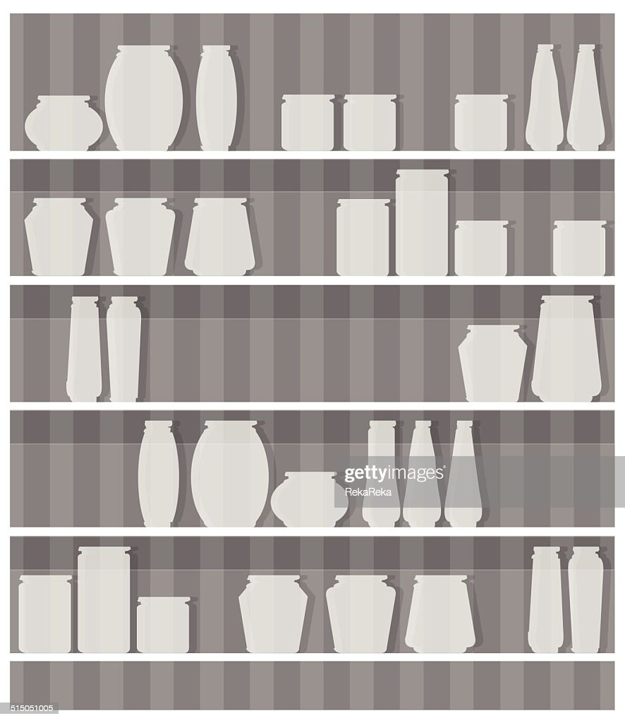 jars on shelf in front of gray striped wall