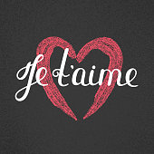 Je t'aime. French lettering. Handwritten romantic quote. Valentine's day. Textured heart. Holiday in February. Calligraphy