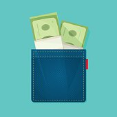 Jeans pocket with pile of money, salary concept, income, expenses