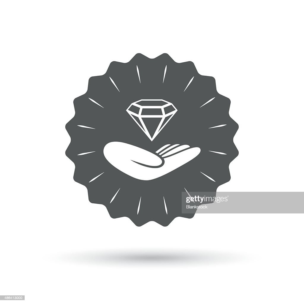 Jewelry insurance sign. Hand holds diamond