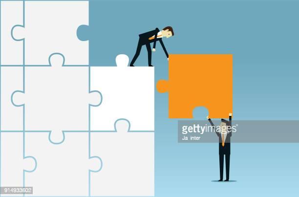jigsaw and business teamwork - jigsaw piece stock illustrations, clip art, cartoons, & icons