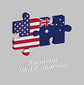 Jigsaw puzzle 3D of America flag and Australia flag with text: Friendship USA & Australia. Concept of Friendly between both countries.