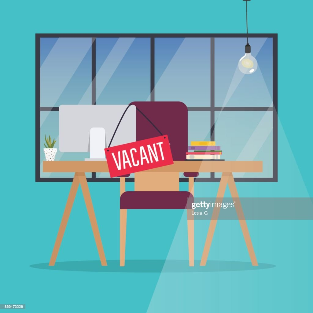 Job vacancy. Office desk with chair, computer and Vacant sign hanged on it. Business hiring and recruiting concept.