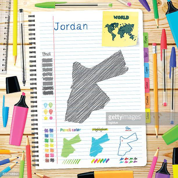 Jordan maps hand drawn on notebook. Wooden Background