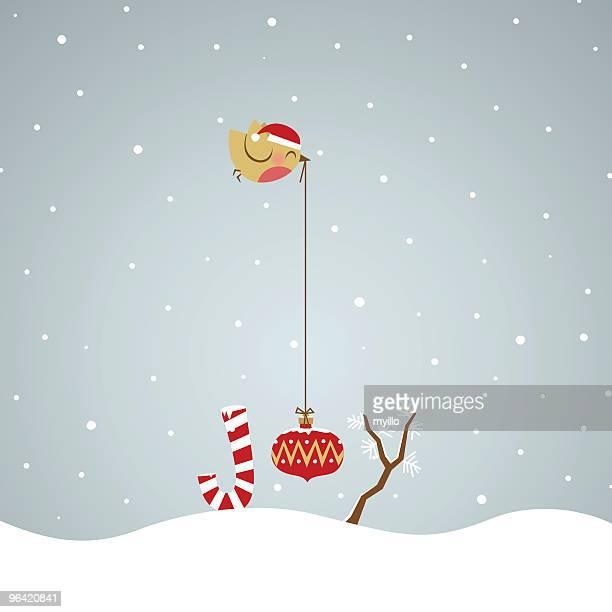 Joy Weihnachten. Robin Vogel mit Weihnachten Glühbirne