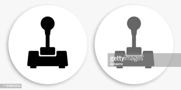 joystick black and white round icon - joystick stock illustrations, clip art, cartoons, & icons
