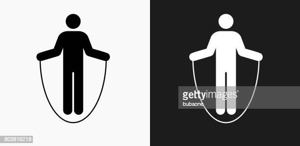 jump rope icon on black and white vector backgrounds - jump rope stock illustrations, clip art, cartoons, & icons