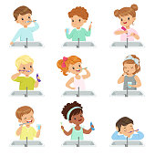 Kids brushing teeth set, cute boys and girls caring for their teeth in bathroom vector Illustration on a white background