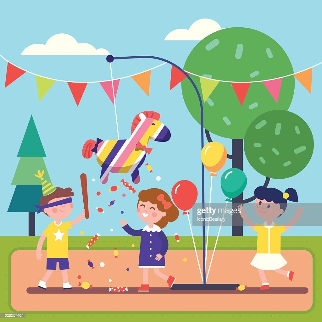 Kids celebrating Posada by breaking a Pinata
