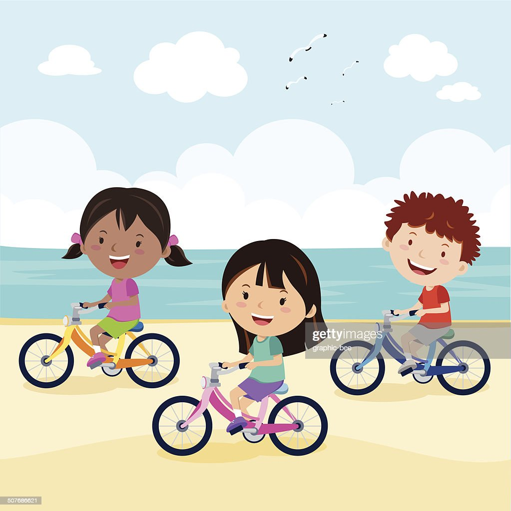 Kids cycling on the beach
