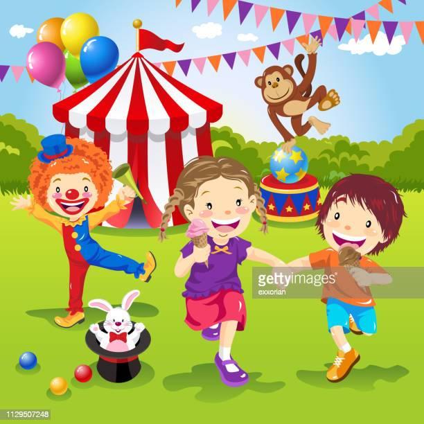 kids enjoying circus entertainment - school carnival stock illustrations, clip art, cartoons, & icons