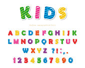 Kids font. Cartoon glossy colorful letters and numbers.