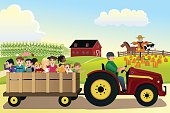 Kids going on a hayride in a farm