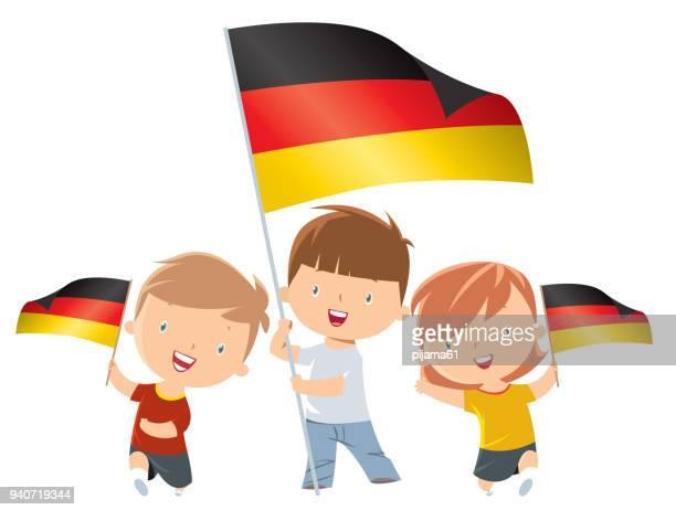 kinder mit deutschland fahne - deutsche flagge stock-grafiken, -clipart, -cartoons und -symbole
