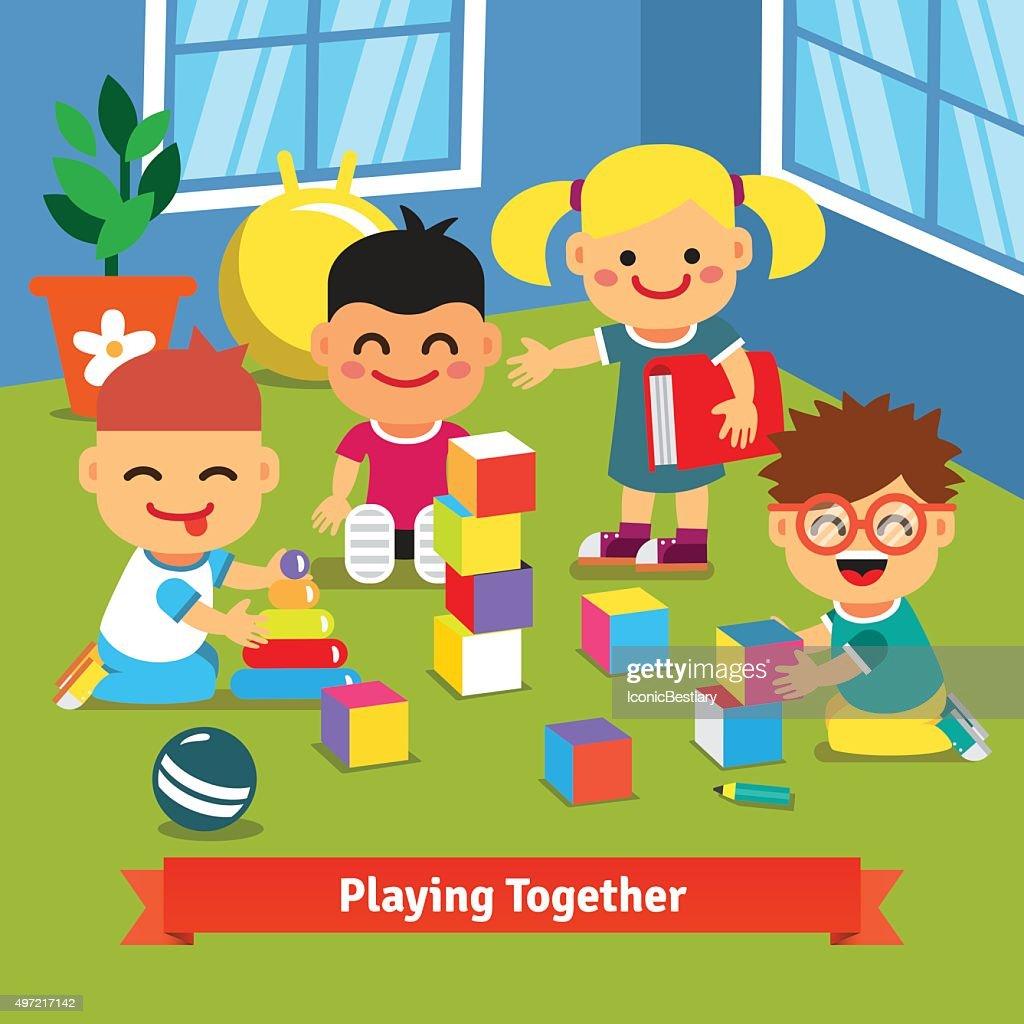 Kids playing together in kindergarten room