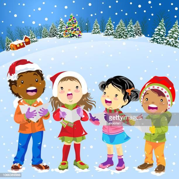 クリスマスの子供の歌を歌いながら
