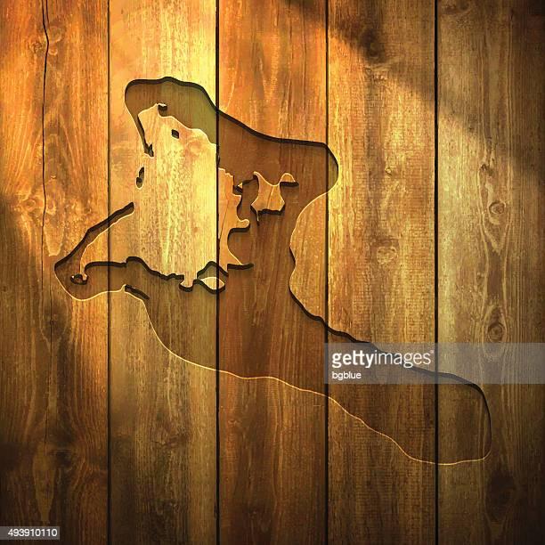 Kiribati Map on lit Wooden Background
