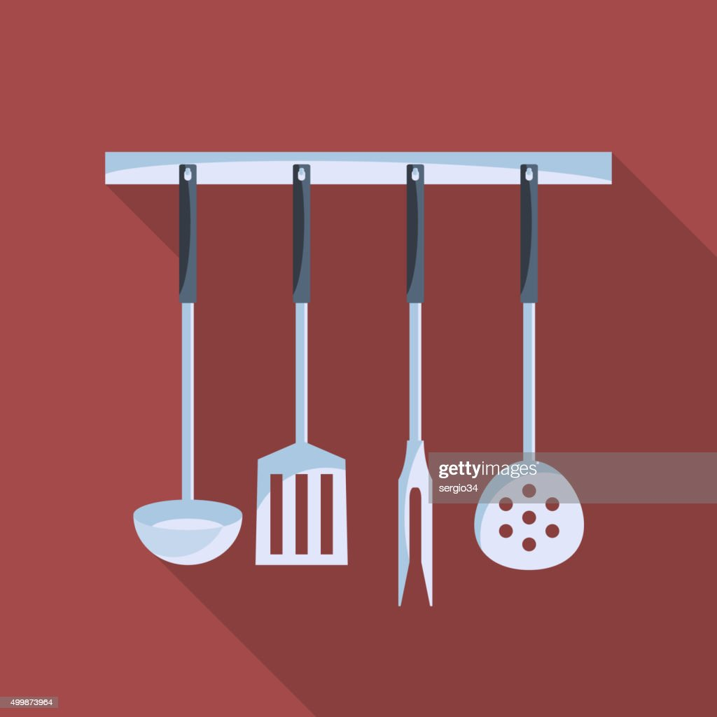 Kitchen tools on  hanger with long shadow.