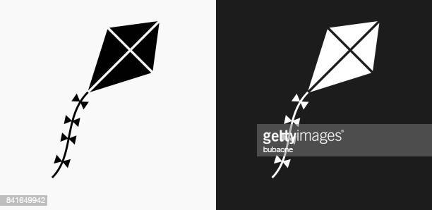 kite icon on black and white vector backgrounds - kite toy stock illustrations, clip art, cartoons, & icons