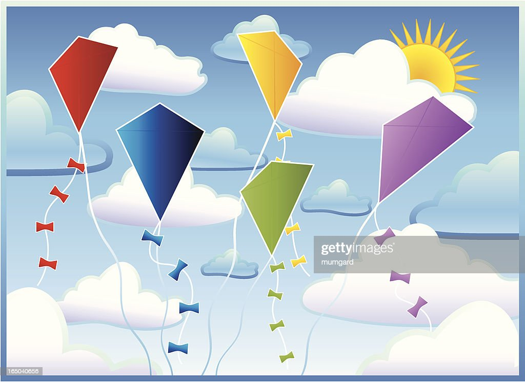 Kites in the clouds against a blue sky