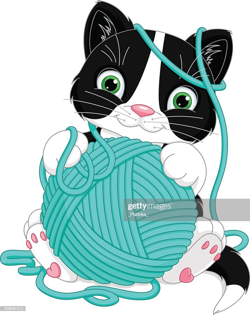 Kitten with yarn ball