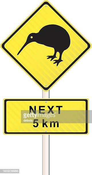kiwi road sign - animal crossing sign stock illustrations