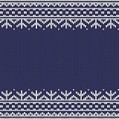 Knitted seamless horizontal winter pattern as a frame - white on blue