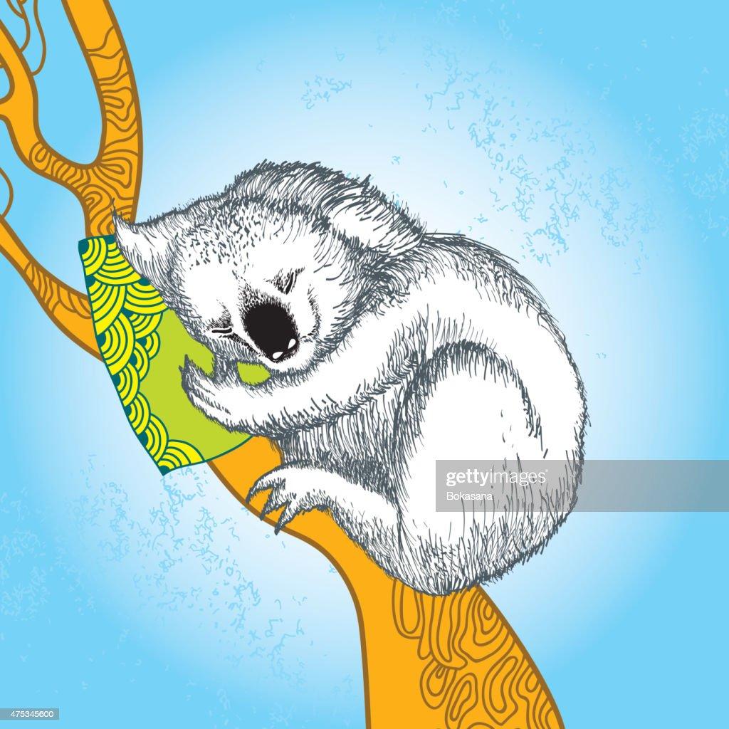 Koala sleeping on the decorative orange branch