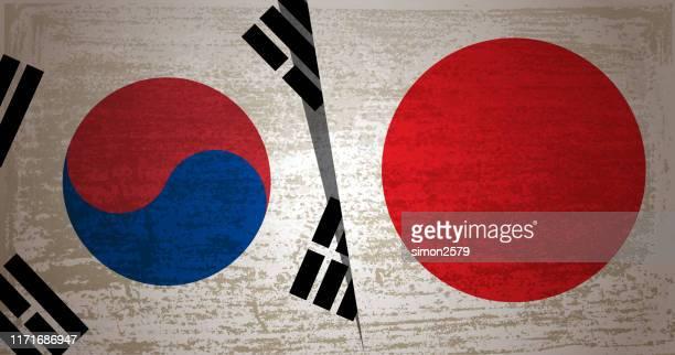 グランジテクスチャの背景を持つ韓国と日本の旗 - フェス点のイラスト素材/クリップアート素材/マンガ素材/アイコン素材