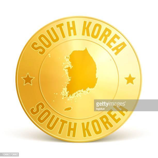 Südkorea - Goldmünze auf weißem Hintergrund