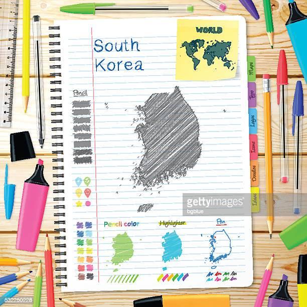 Südkorea Karten handgezeichnet auf notebook. Hölzerner Hintergrund
