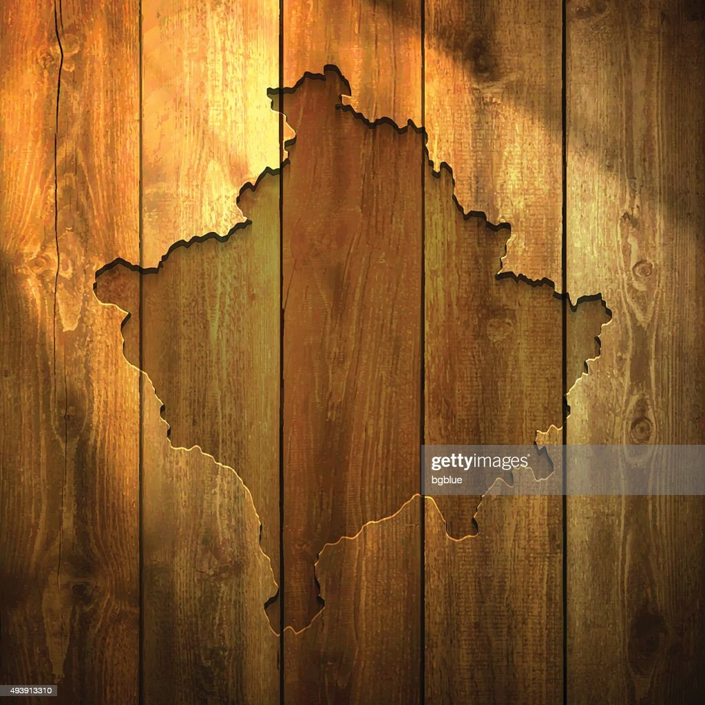 Kosovo Map on lit Wooden Background : stock illustration