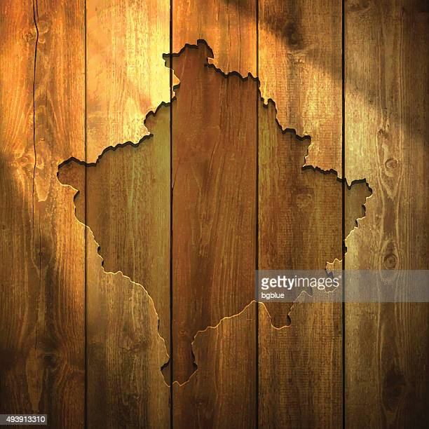 Kosovo Map on lit Wooden Background