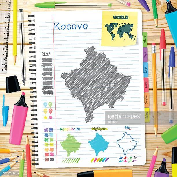 Kosovo maps hand drawn on notebook. Wooden Background