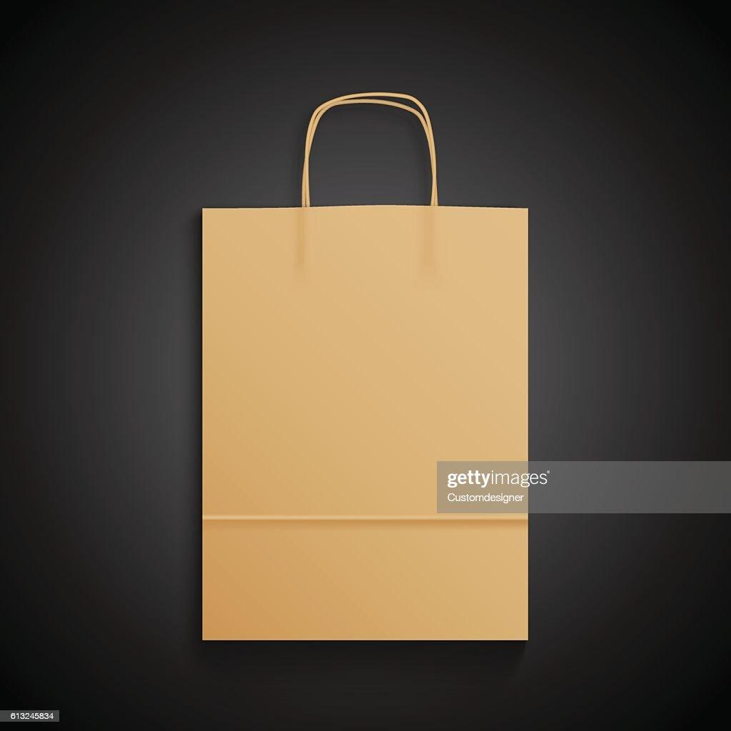 Kraft paper bag with handles on black background. Mock up
