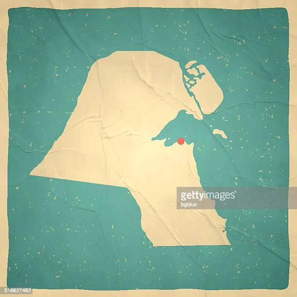 kuwait map on old paper - vintage texture - kuwait stock illustrations, clip art, cartoons, & icons