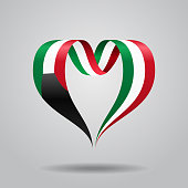 Kuwaiti flag heart-shaped ribbon. Vector illustration.